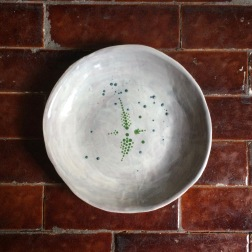 shallow bowl with green dots